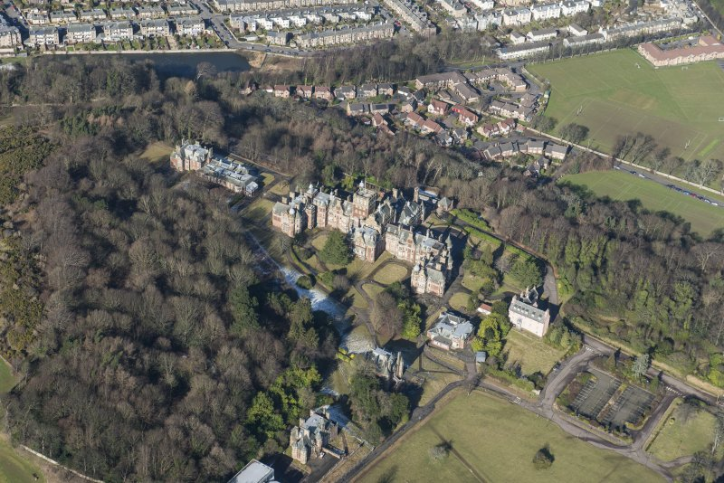 Oblique aerial view of New Craig House, Queen's Craig House, East Craig House, Bevan House and Old Craig House, looking NNW.