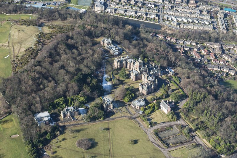 Oblique aerial view of New Craig House, Queen's Craig House, East Craig House, Bevan House, South Craig House, The New Learning Resource Centre and Old Craig House, looking WNW.