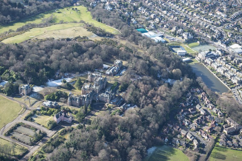 Oblique aerial view of New Craig House, Queen's Craig House, East Craig House, South Craig House and Old Craig House, looking SW.