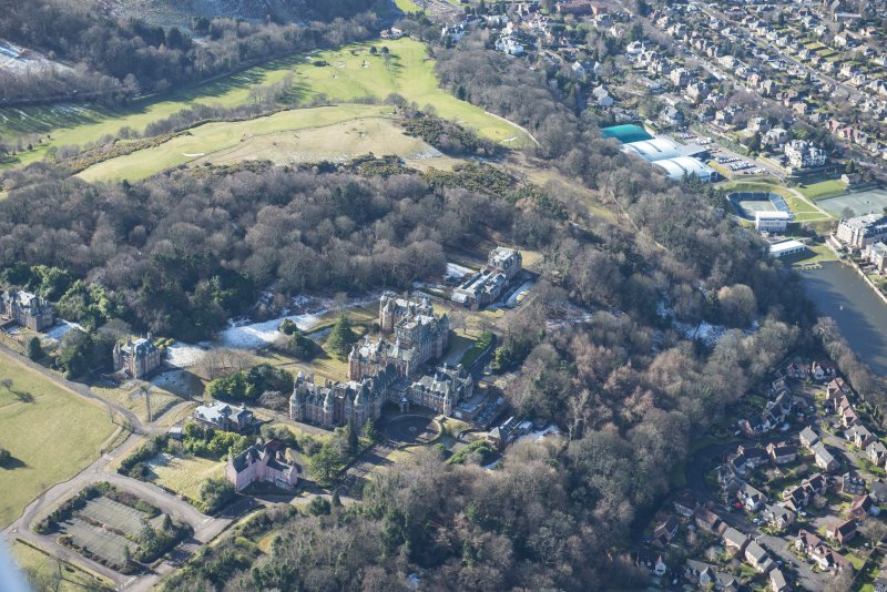 Oblique aerial view of New Craig House, Queen's Craig House, East Craig House, South Craig House and Old Craig House, looking SSW.