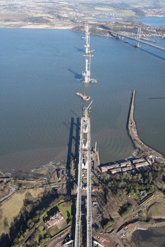 Oblique aerial view of the construction of the Queensferry Crossing on the south bank of the River Forth, looking NNE.