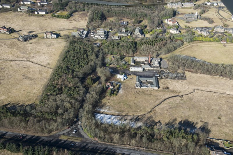 Oblique aerial view of Bangour Village Hospital Block, Recreation Hall, Church and Maintenance Block, looking NW.