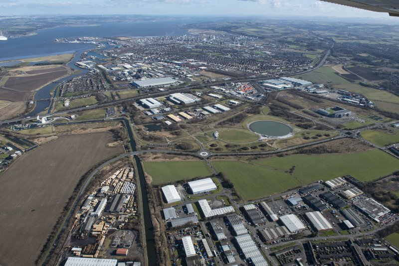 General oblique aerial view of the Grangemouth area centred on The Helix, the town of Grangemouth and Grangemouth oil refinery, looking NE.