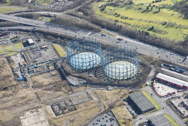 Oblique aerial view of Provan Gasworks including gasholders, looking SE.