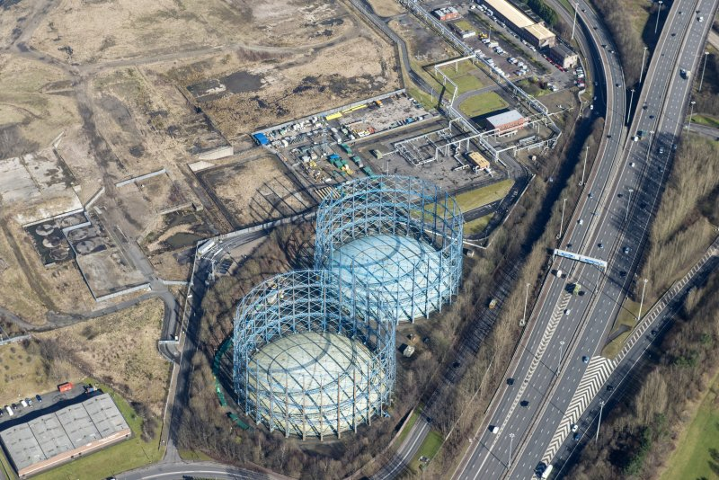 Oblique aerial view of Provan Gasworks including gasholders, looking NNE.