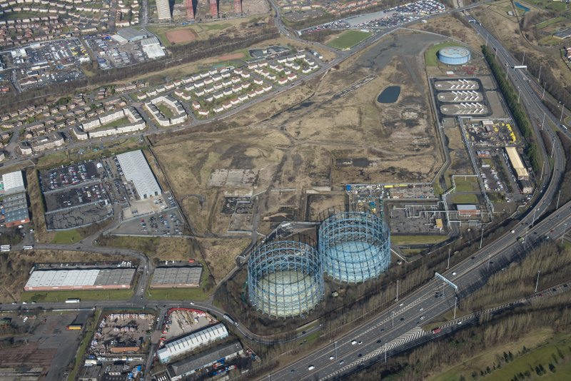 Oblique aerial view of Provan Gasworks including gasholders, looking N.