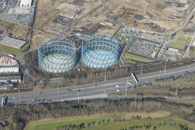 Oblique aerial view of Provan Gasworks including gasholders, looking NNW.