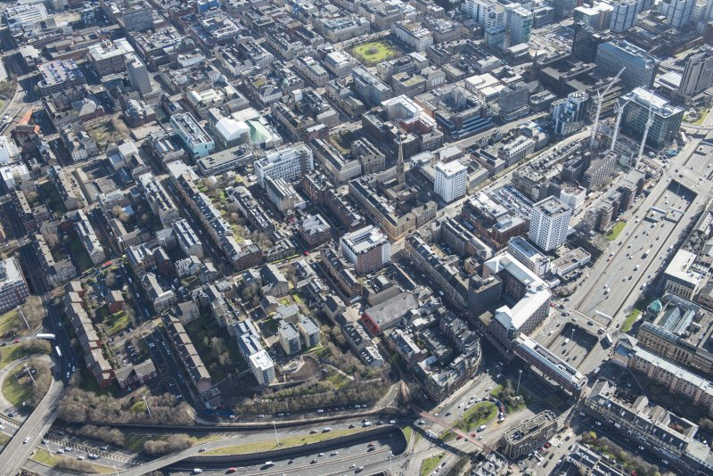 Oblique aerial view of the west end of Glasgow City Centre, Garnethill and Charing Cross, looking SE.
