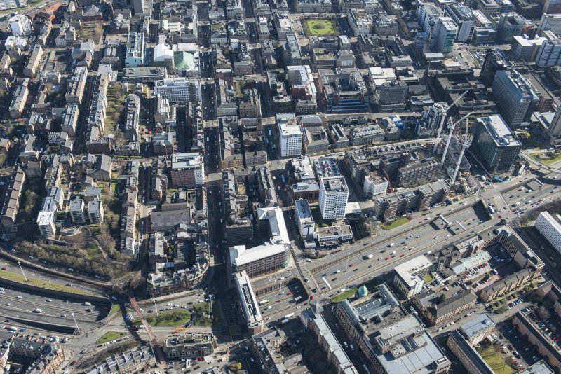 Oblique aerial view of the west end of Glasgow City Centre, Sauchiehall Street, Garnethill and Charing Cross, looking ESE.