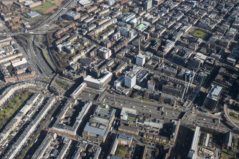 Oblique aerial view of the west end of Glasgow City Centre, Garnethill and Charing Cross, looking ENE.