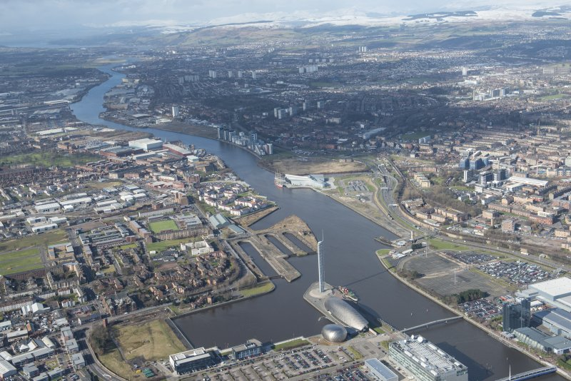 General oblique aerial view of Glasgow centred on the River Clyde and Meadowside Quay, looking NW.