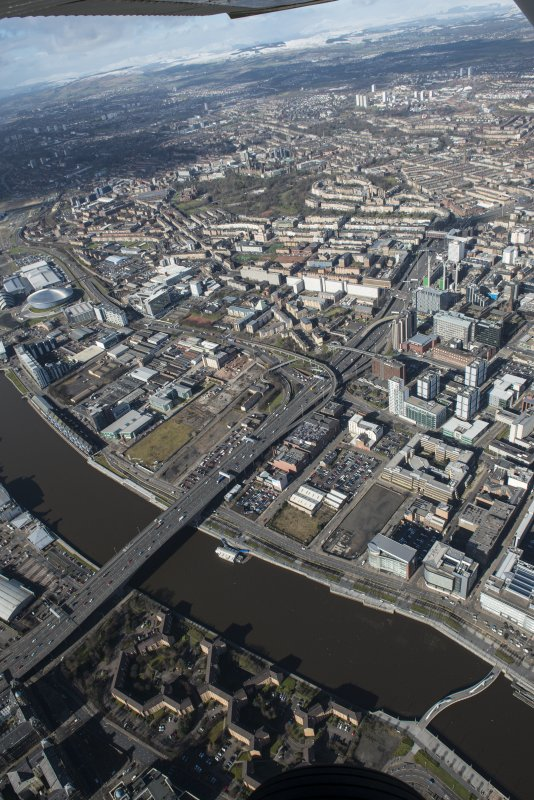 Oblique aerial view of Glasgow, Kingston Bridge and Tradeston Bridge, looking NW.