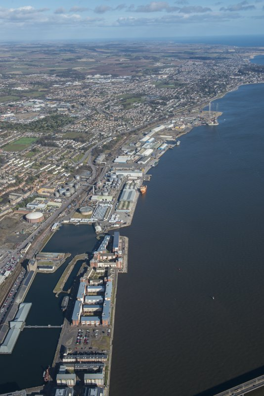 General oblique aerial view of the harbour area of Dundee centred on Camperdown Dock and King V Wharf, looking NNE.