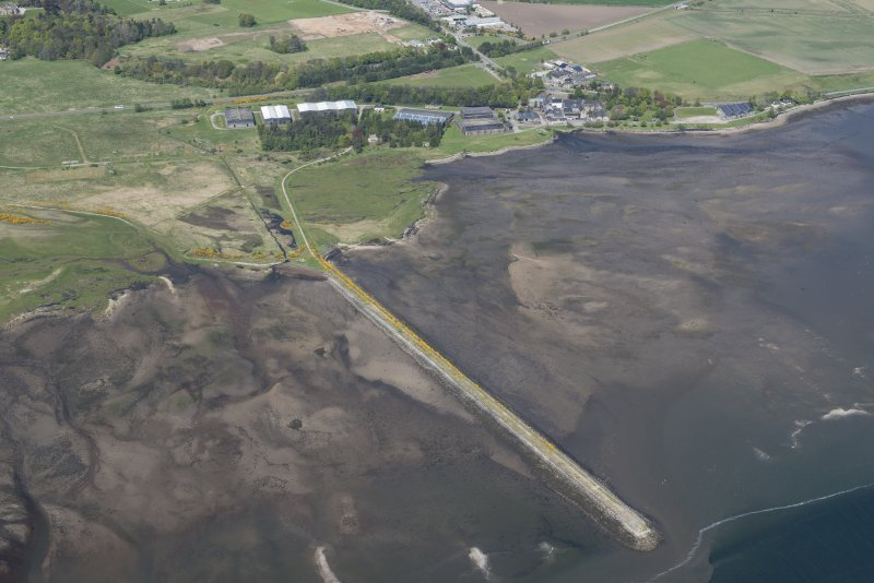 Oblique aerial view of fishing stands on the River Alness, Dalmore Distillery and pier, looking NNW.