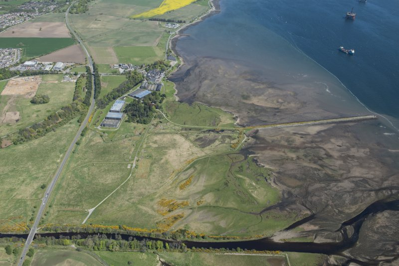 General oblique aerial view of Dalmore Distillery and pier, looking NW.