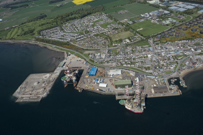 Oblique aerial view of Invergordon harbour and oil rig service base, looking N.