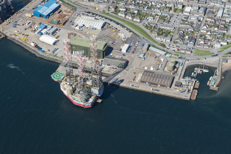 Oblique aerial view of Invergordon harbour and oil rig service base, looking NNW.