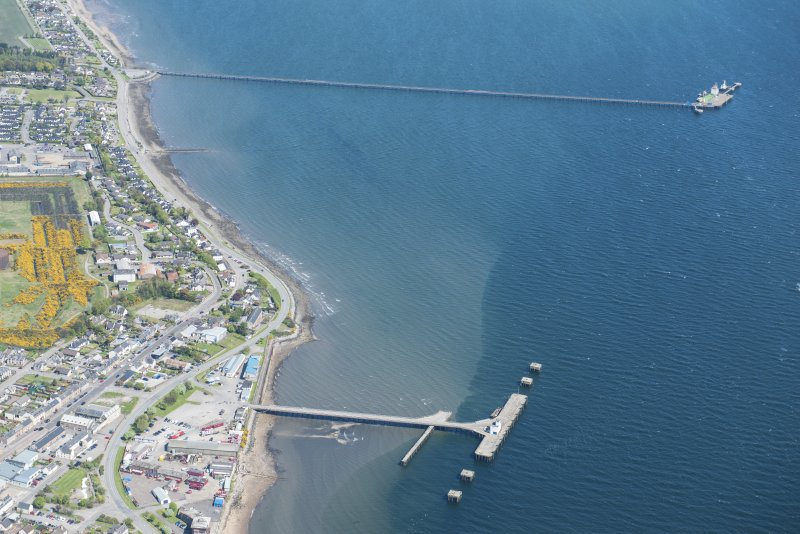 Oblique aerial view of Invergordon East Pier, looking NW.