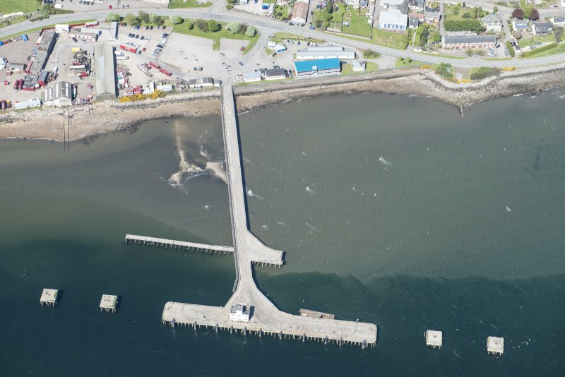 Oblique aerial view of Invergordon East Pier, looking N.
