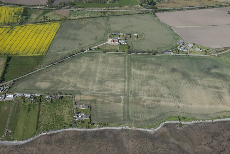 Oblique aerial view of the soilmarks at Polnico, looking NW.