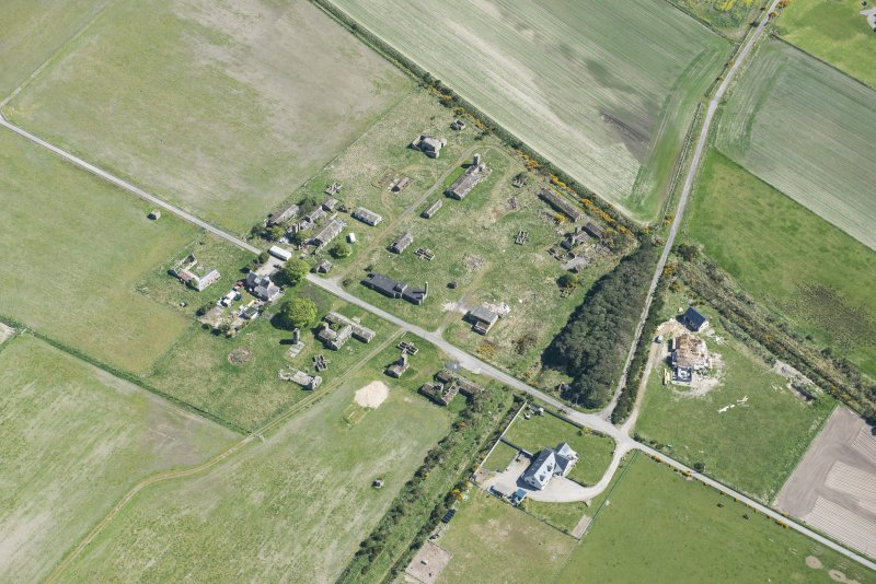 Oblique aerial view of Fearn Airfield accomodation camp, looking ESE.
