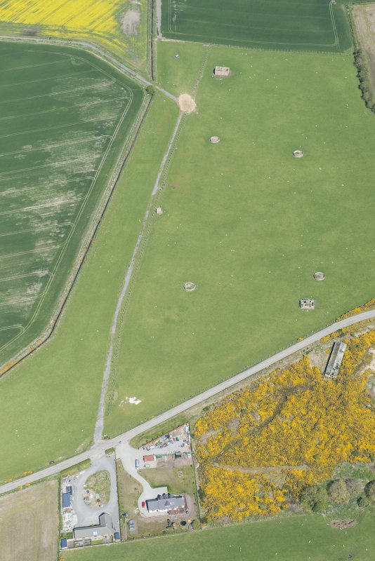 Oblique aerial view of Fearn Airfield military camp, looking NE.