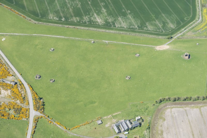 Oblique aerial view of Fearn Airfield military camp, looking NW.