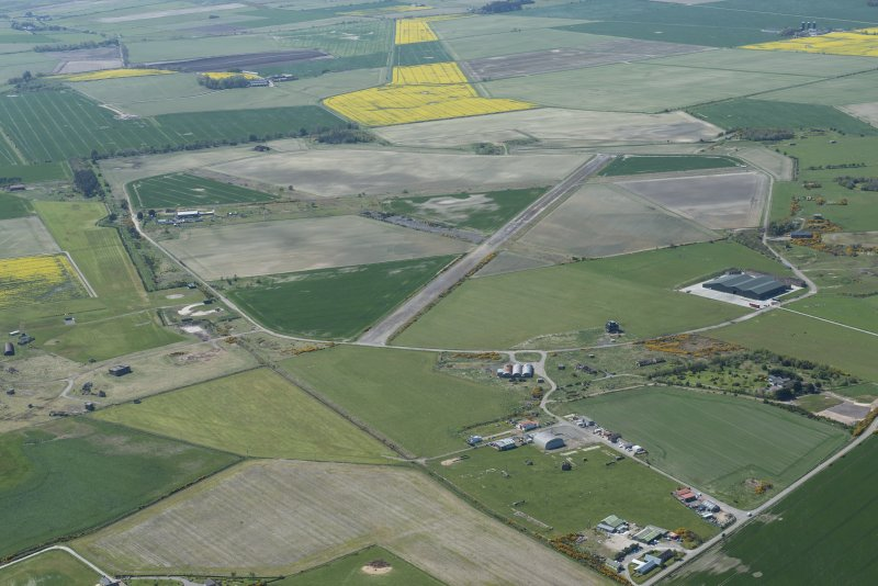 General oblique aerial view of Fearn Airfield, looking SW.