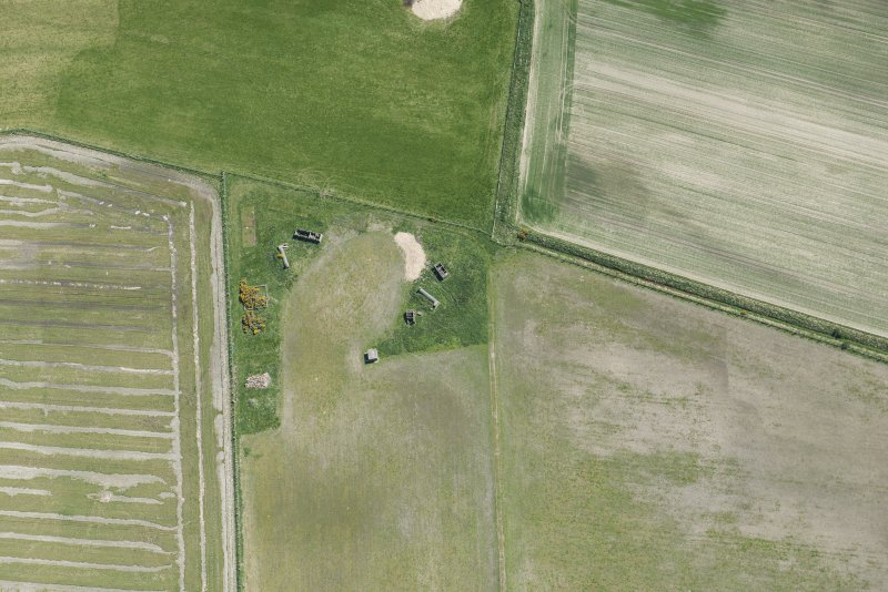 Oblique aerial view of Fearn Airfield military camp, looking SE.