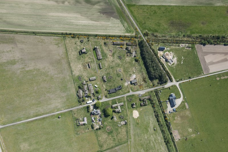 Oblique aerial view of Fearn Airfield accomodation camp, looking SE.