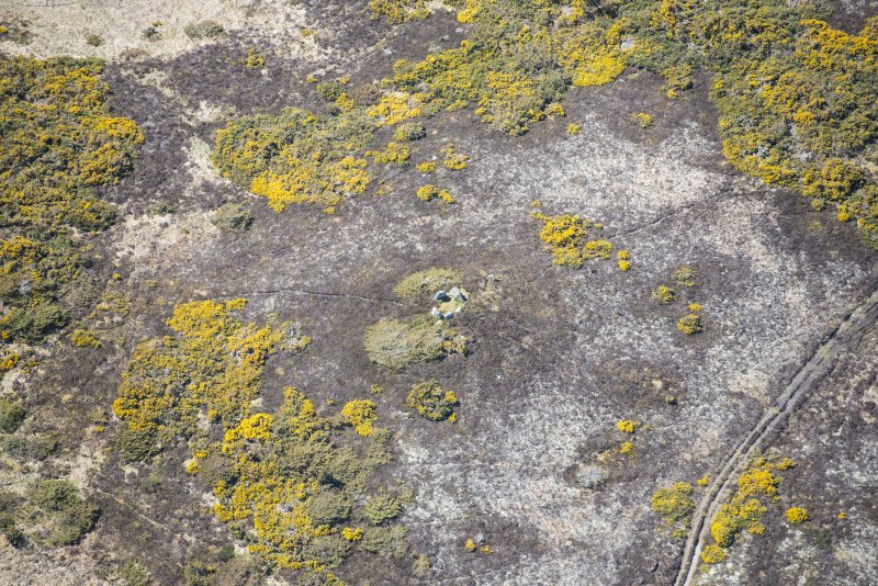Oblique aerial view of the Heights of Brae chambered cairn, looking W.
