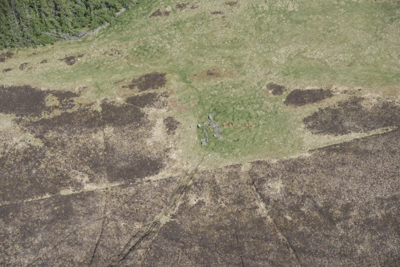 Oblique aerial view of the Balnacrae chambered cairn, looking NNE.