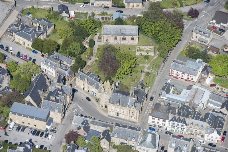 Oblique aerial view of St Duthus's Collegiate Church and Tolbooth in Tain, looking N.