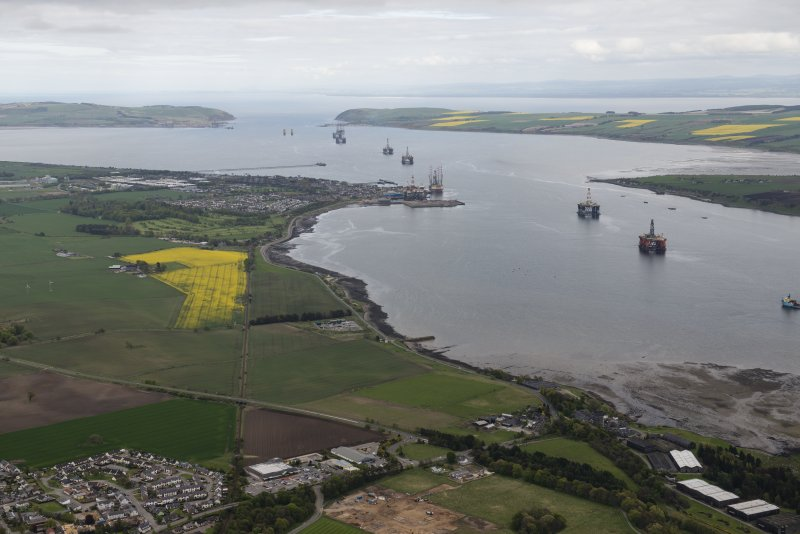 General oblique aerial view centred on Invergordon with the Cromarty and Moray Firths beyond, looking E.