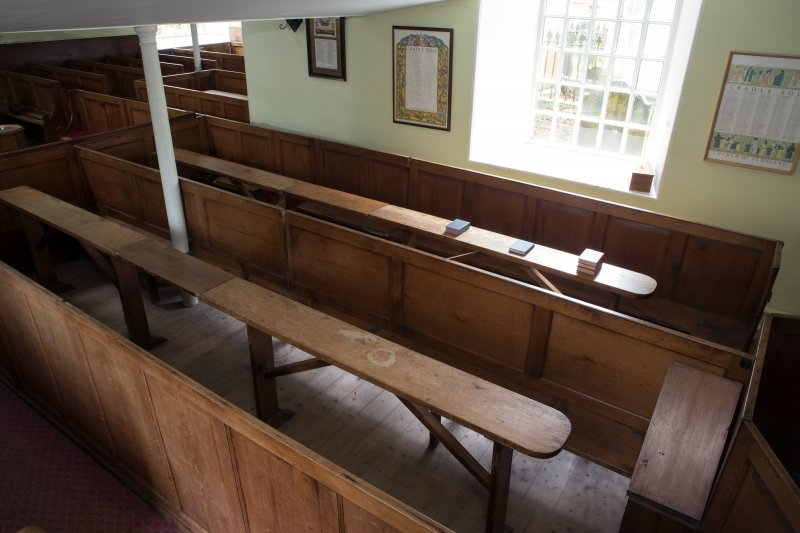 Durisdeer Parish Church. South Aisle View of communion box pews converted into communion tables from South West.