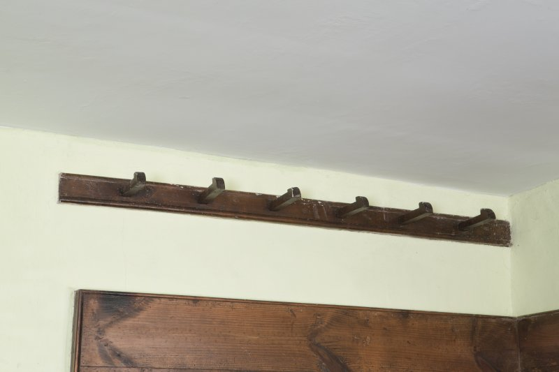 Durisdeer Parish Church. Detail of coat hooks above box pew of West gallery.