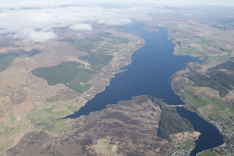 General oblique aerial view of Loch Shin centred on Lairg power station and dam, looking NW.