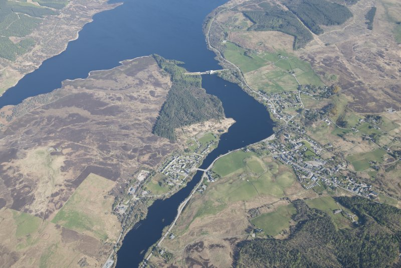 General oblique aerial view of Lairg with the power station and dam beyond, looking NW.