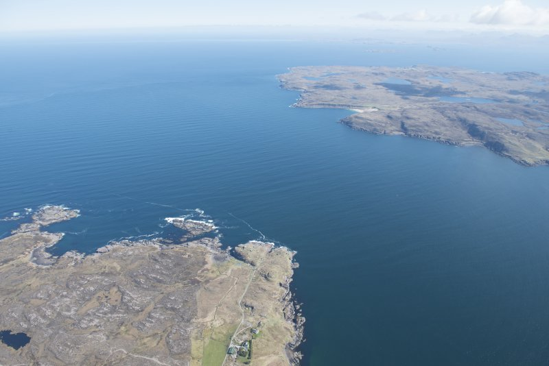 General oblique aerial view centred on Rubha nan Sasan with Slaggan Bay beyond, looking NE.