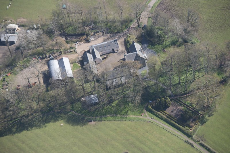 Oblique aerial view of Wester Kittochside Farm, looking ENE.