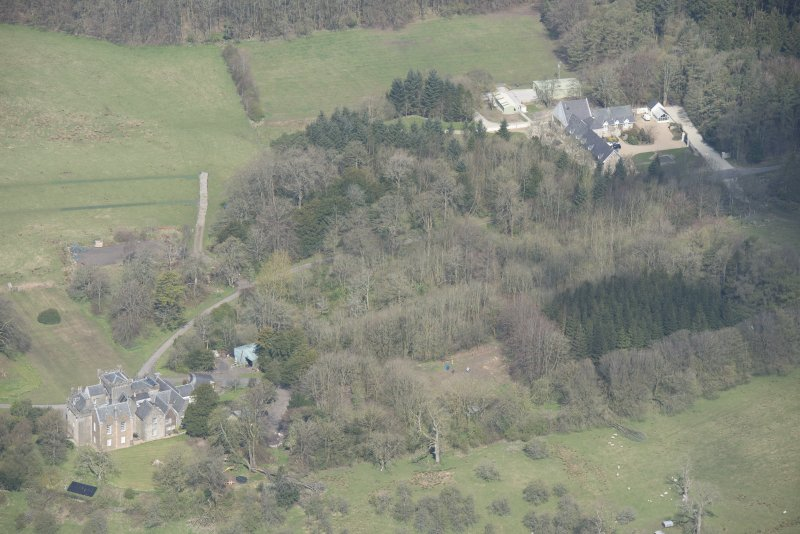 Oblique aerial view of Craufurdland Castle, looking NW.