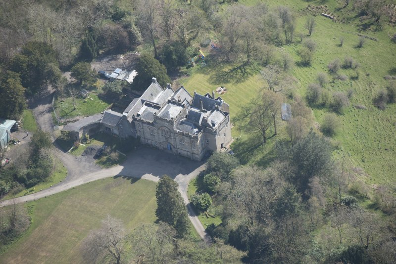 Oblique aerial view of Craufurdland Castle, looking SE.