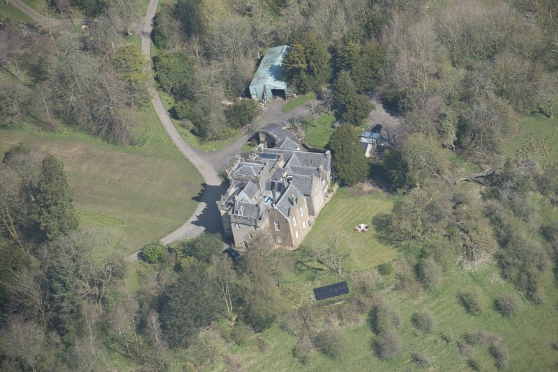 Oblique aerial view of Craufurdland Castle, looking NE.