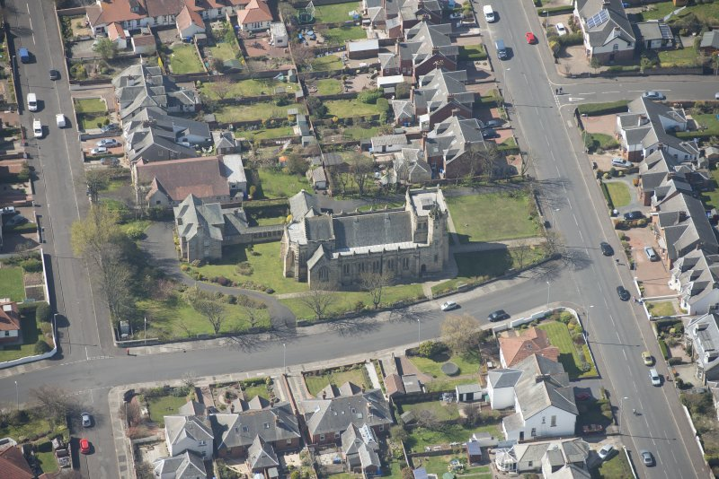 Oblique aerial view of the Chapel of our Lady of the Assumption and St Meddan Church, looking SW.