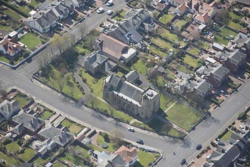 Oblique aerial view of the Chapel of our Lady of the Assumption and St Meddan Church, looking SSW.