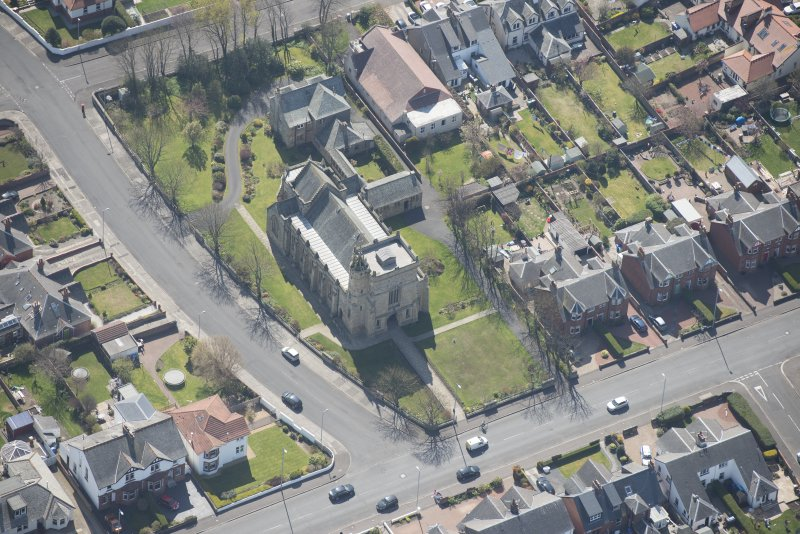 Oblique aerial view of the Chapel of our Lady of the Assumption and St Meddan Church, looking S.