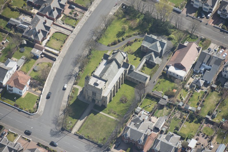 Oblique aerial view of the Chapel of our Lady of the Assumption and St Meddan Church, looking SE.
