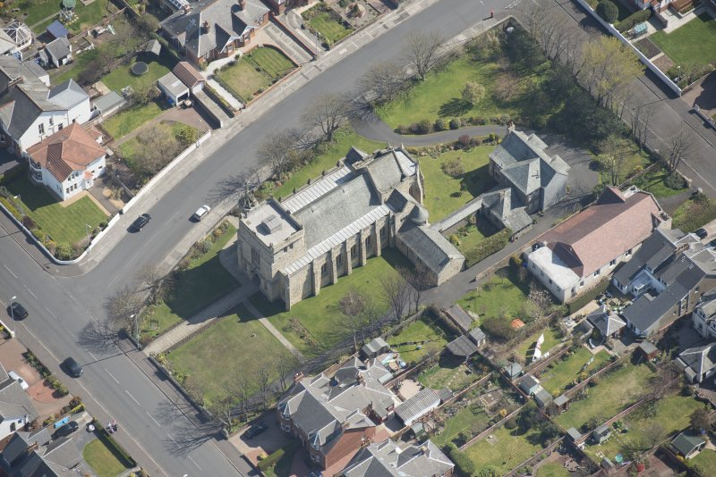 Oblique aerial view of the Chapel of our Lady of the Assumption and St Meddan Church, looking ESE.