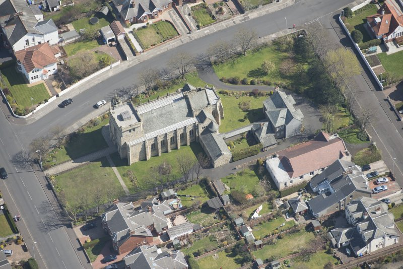 Oblique aerial view of the Chapel of our Lady of the Assumption and St Meddan Church, looking ENE.