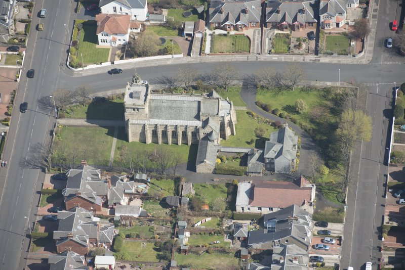 Oblique aerial view of the Chapel of our Lady of the Assumption and St Meddan Church, looking NE.